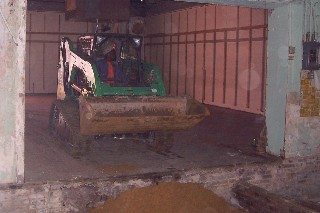 Hauling in dirt to level floor